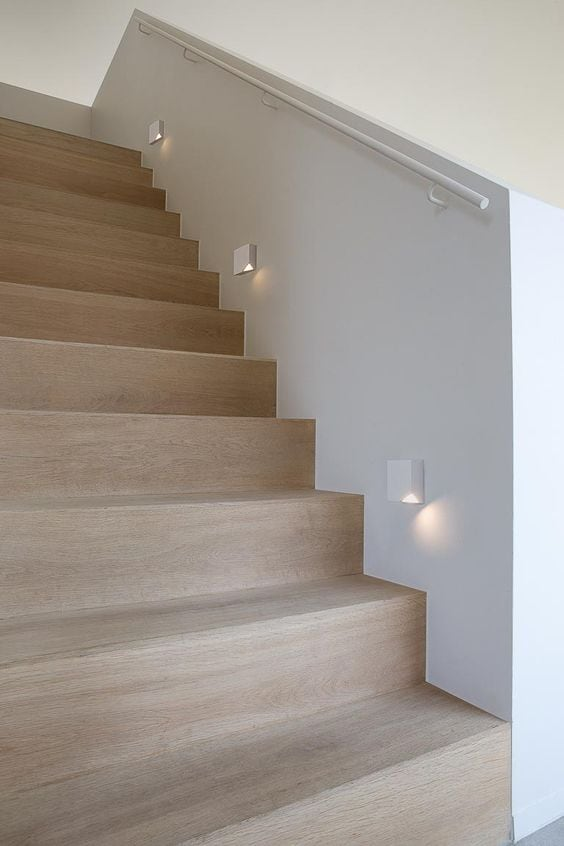Creative ways to light your stairs dmlights blog wall lights with a modern stairway mozeypictures Image collections