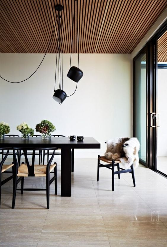 living room with flos aim pendant lamps above the table