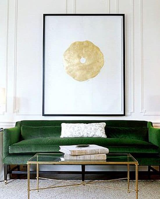 Emerald Green Sofa With Golden Artwork Above