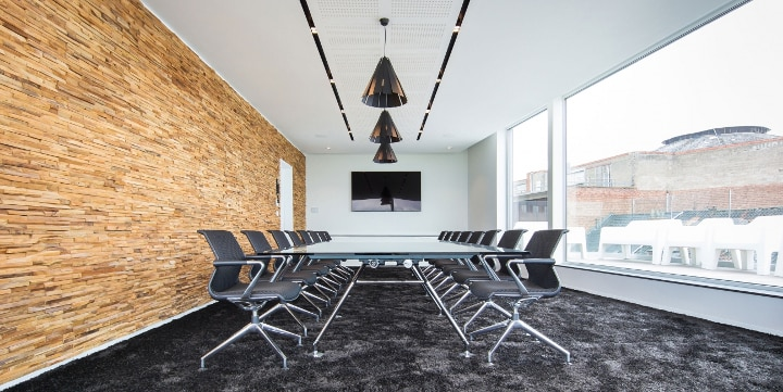 Stylish office lighting with DeltaLight Metronome fixtures.